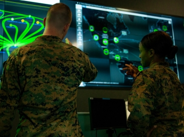 Marines with Marine Corps Forces Cyberspace Command pose for photos in the cyber operations center at Lasswell Hall