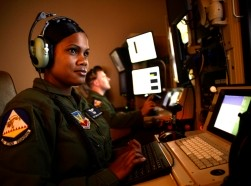 A sensor operator and pilot follow a vehicle with a remotely piloted aircraft in a flight training simulator