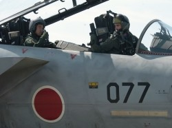 A U.S. pilot (right) gives a thumbs up to a Japanese pilot (left)