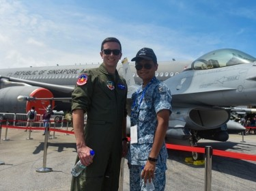 A U.S. pilot stands next to a member of the Republic of Singapore Air Force