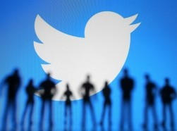 People standing in front of a Twitter logo, photo illustration by Pavlo Gonchar/SOPA Images/Sipa USA