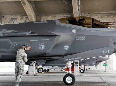 Senior Airman Colby Cook, 419th Aircraft Maintenance Squadron crew chief, inspects an F-35A Lightning II before takeoff at Kadena Air Base, Japan, Nov. 16, 2017. The F-35A is the Air Force's latest low observable fifth-generation fighter incorporating stealth technology, photo by Naoto Anazawa/U.S. Air Force