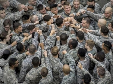 Airmen join in a group huddle at the conclusion of the Police Week Memorial 5K Ruck March at Yokota Air Base, Japan, May 15, 2017. The airmen are assigned to the 374th Security Forces Squadron, photo by Airman 1st Class Donald Hudson/U.S. Air Force