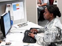 Sergeant Jennifer Jackson, III Corps, works at her computer station in the Inspector General's office.