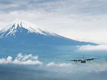 A formation of C-130 Hercules cargo aircraft fly in formation as they return from the Samurai Surge training mission near Mount Fuji, Japan, June 5, 2012