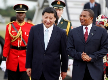 China's President Xi Jinping (left) walks with his Tanzanian counterpart Jakaya Kikwete upon his arrival in Dar es Salaam, Tanzania, March 2013