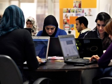 Jordanian youth use laptop computers