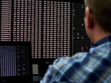 An analyst looks at code in the malware lab of a cyber security defense lab at the Idaho National Laboratory