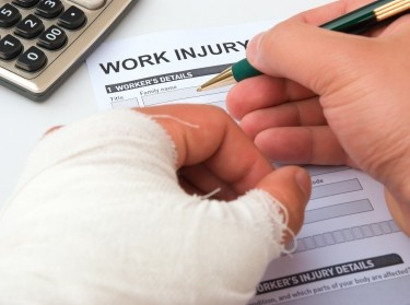 Person filling out a work injury claims form