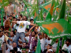 Supporters of the Pakistan Muslim League (N) party cheer their leader, Nawaz Sharif (not pictured), during a campaign rally in Islamabad, Pakistan, May 2013