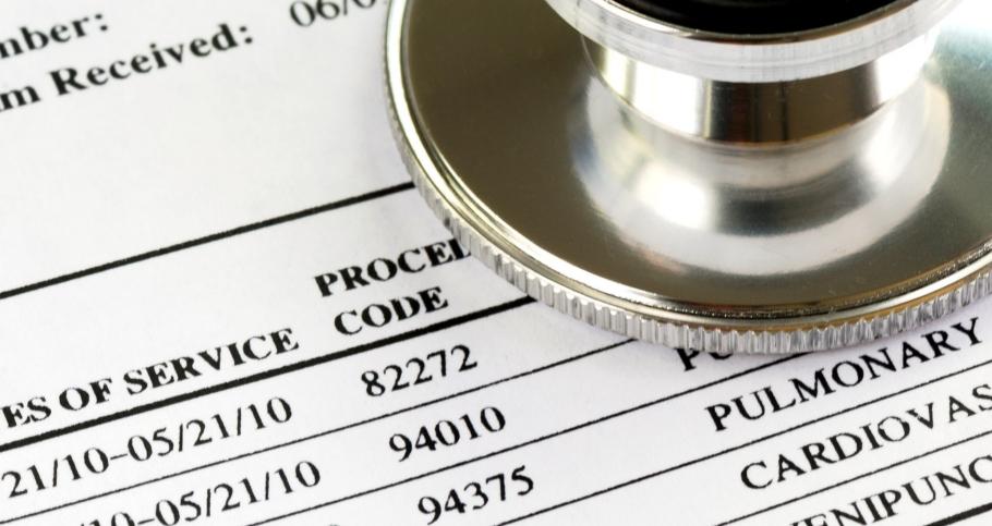 A stethoscope and a health insurance claim