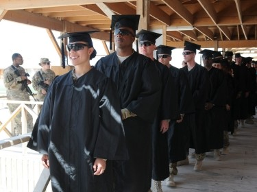 U.S. soldiers in line for the first-ever Kandahar Airfield college graduation ceremony, Afghanistan, May 23, 2012