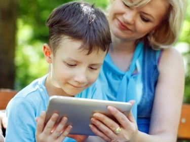Little boy with tablet and mother