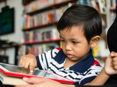 Young Asian boy with tablet