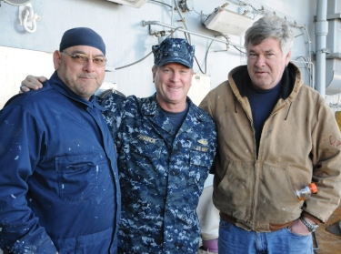 Rear Adm. T.K. Shannon, commander, Military Sealift Command, poses for a photo with Able Seamen Andrew Vogelheim and James Coakley