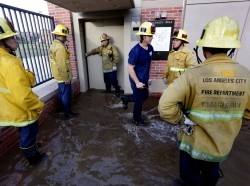 Los Angeles firefighters standing in a flood