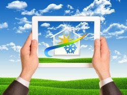 Holding a tablet computer with a weather icon