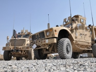 A mine-resistant, ambush-protected all-terrain vehicle, built specifically for the mountainous Afghan terrain, parked next to the larger MRAP, MaxxPro Dash