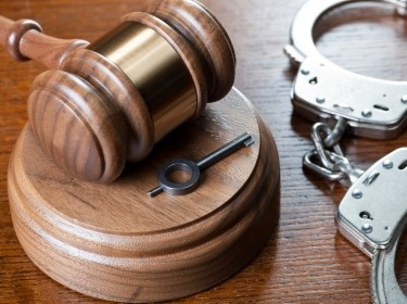 A gavel and handcuffs