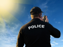 Police officer using radio to communicate