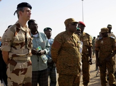 Brigade General Gregoire de Saint-Quentin (L), head of France's Operation Serval in Mali, stands with General Nabere Honore Traore, army chief of Burkina Faso, during a handover ceremony of the Timbuktu mission, April 23, 2013