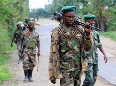 Congolese M23 rebels patrol near Rushuru, in DRC August 2013 as a deadline set by UN peacekeepers for rebels to lay down their weapons passes