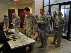 Soldiers line up to check in for the CivilianJobs.com job fair sponsored by the Fort Campbell, Ky., Army Career and Alumni Program office