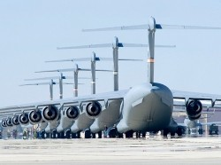 C-17 Globemaster IIIs sit on the flight line at Edwards Air Force Base, California, in preparation for six-ship formation testing