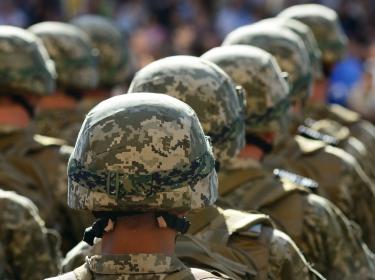 Rows of soldiers in helmets