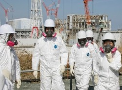 Tokyo Electric Power Company workers stand outside the Fukushima Dai-Ichi nuclear power plant in Japan, February 28, 2012