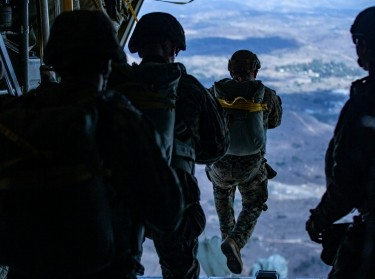 U.S Marines static line jump from a KC-130J Hercules over Drop Zone Basilone on Marine Corps Base Camp Pendleton, Calif., December 10, 2020, photo by Lance Cpl. Drake Nickels/U.S. Marine Corps