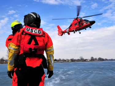 Crew members from Coast Guard Air Station Detroit perform helicopter-rescue training, March 10, 2010