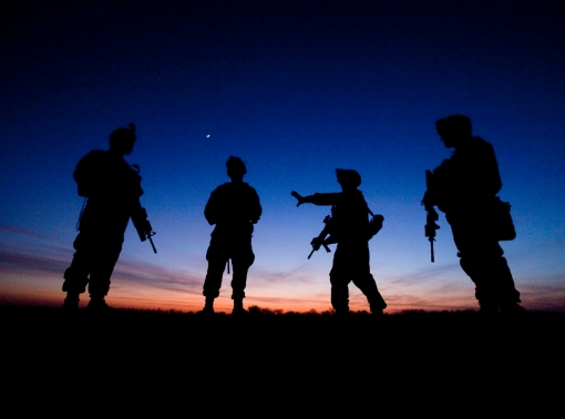 U.S. service members at a crossroads at dusk in Helmand Province, Afghanistan, December 2009