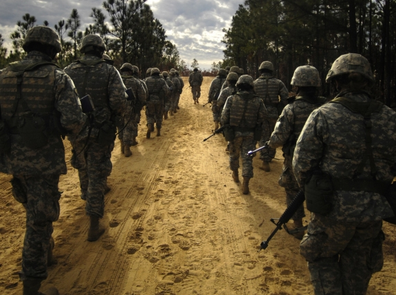 U.S. Army recruits practice patrol tactics while marching during basic training at Fort Jackson, South Carolina, December 6, 2006, photo by SSgt Shawn Weismiller/U.S. Air Force