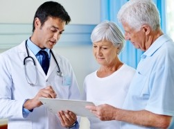 Doctor consulting with elderly patients