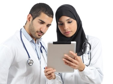 Two doctors looking at a tablet