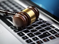 Gavel on laptop computer keyboard concept for online internet auction or legal assistance