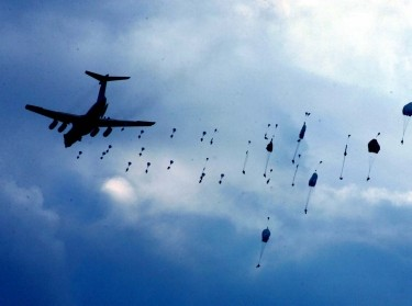Chinese airborne troops parachute in an amphibious landing drill during the Sino-Russian 'Peace Mission 2005' joint military exercise, held in China's Shandong Peninsula in 2005
