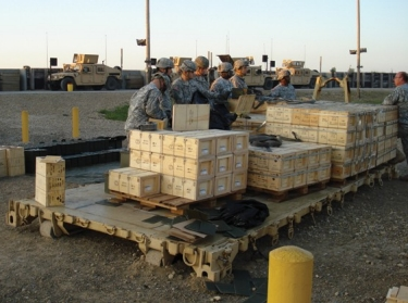 Soldiers cross-check part of a 90-ton shipment of military supplies at Kabul International Airport, Afghanistan.