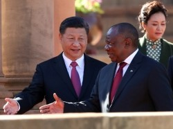 China's President Xi Jinping walks with South African President Cyril Ramaphosa before their meeting in Pretoria, South Africa, July 24, 2018