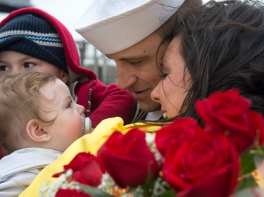 U.S. Navy Operations Specialist 2nd Class Gary Viator reunites with his family
