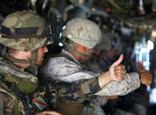 U.S. and Spanish Marines signal acknowledgement