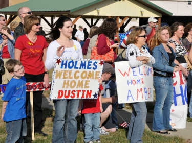 Family members welcome home their heroes at Hulman Field Air National Guard Base, Ind.