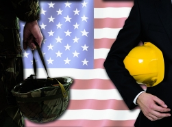 A soldier and a developer standing in front of an American flag
