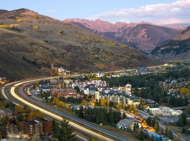 I-70 winding around Vail, Colorado with mountains in the distance