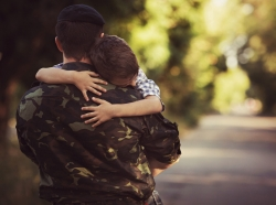 A military father and son hugging