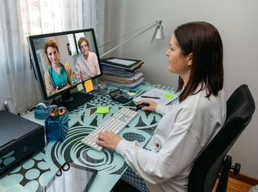 Doctor on a video call with nurse and patient, photo by doble-d/Getty Images