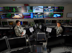 Staff Sgt. Alex Garviria, 721st Communication Squadron senior systems controller, and 2nd Lt. Rachel James, 721st CS crew commander, work in the Global Strategic Warning and Space Surveillance System Center at Cheyenne Mountain Air Force Station, Colo., Sept. 2, 2014, photo by Airman 1st Class Krystal Ardrey/U.S. Air Force