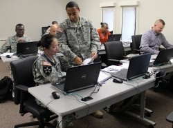 Army Contracting Command-New Jersey's Maj. Bonny Dylewski and Capt. Reginald Gholston take part in the contingency contracting administration services mission training Oct. 29, photo by U.S. Army