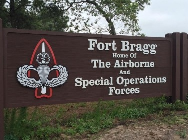 Sign that says Fort Bragg, Home of the Airborne and Special Operations Forces, photo by U.S. Army